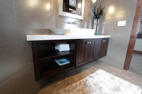 Thumb vanity  contemporary style  beech  dark stain  recessed panel  wide frame  full overlay  open cubbies  single sink  angled back