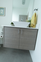 Thumb vanity  contemporary style  custom laminate  banded door  floating  frameless construction  single vessel sink