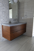Thumb vanity  contemporary style  walnut  medium color  banded door  frameless construction  floating