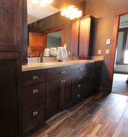 Thumb vanity  craftsman style  hard maple  dark color  recessed panel  bank of drawers  towers  linen  full overlay