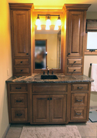 Thumb vanity  craftsman style  quartersawn oak  dark color  raised panel  flush mount  two towers  bank of drawers