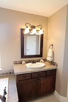 Thumb vanity  shaker style  knotty alder  dark color   recessed panel  single sink  standard overlay