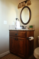 Thumb vanity  traditional style  knotty alder  dark color  raised panel  single sink  full overlay