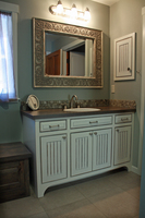 Thumb vanity  traditional style  painted with glaze  wainscot panel  flush mount  bevel drawer fronts  medicine cabinet  arched toekick  accent color bench seat