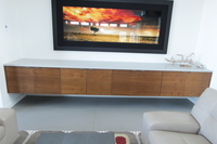 Thumb great room  contemporary style  walnut  medium color  banded door  entertainment center  floating base cabinet  horizontal grain  frameless construction