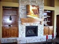Thumb great room  craftsman style  knotty alder  raised panel  medium color  mantle and fireplace  bookcase built ins  standard overlay