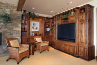 Thumb great room  traditional style   knotty alder  dark color  raised panel  entertainment center  accent color black onlays  bookcase  open cubbies at the top  standard overlay