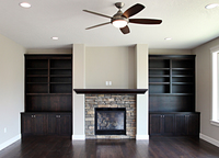 Thumb great room  traditional style  western maple  dark  black  color  wainscot panel  mantel  bookshelves  entertainment center  fireplace built ins  full overlay