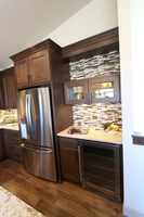 Thumb kitchen  contemporary style  clear alder  dark color  recessed panel  short cabinet with glass doors  valance  full overlay