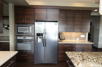 Thumb kitchen  contemporary style  quartersawn walnut  banded door  dark color  butler pantry  square crown  full overlay  double oven cabinet