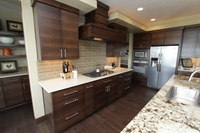 Thumb kitchen  contemporary style  quartersawn walnut  banded door  dark color  custom wood hood  butler pantry  floating shelves  double oven cabinet  full overlay  2