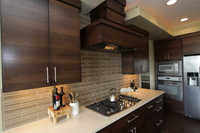 Thumb kitchen  contemporary style  quartersawn walnut  banded door  dark color  custom wood hood  butler pantry  floating shelves  double oven cabinet  full overlay  3