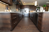 Thumb kitchen  contemporary style  quartersawn walnut  banded door  dark color  custom wood hood  full overlay