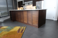 Thumb kitchen  contemporary style  quartersawn walnut  dark color  banded door  frameless construction
