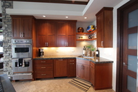 Thumb kitchen  contemporary style  sapele  medium color  recessed panel  corner sink  dishwasher front panel  corner floating shelves  full overlay