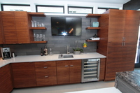 Thumb kitchen  contemporary style  walnut  medium color  banded door  frameless construction  open shelves  corner optimizer  bank of drawers  horizontal grain match