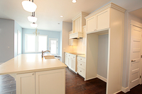 Thumb kitchen  shaker style  painted  recessed panel and wainscot panel  wood hood  apron sink in island   13 crown  36 high island overhang   4 bar supports  door on end of island  full overlay