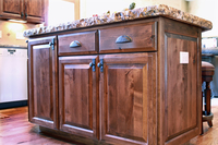 Thumb kitchen  traditional style  knotty alder  dark color  raised panel  raised panel end with outlet  full overlay