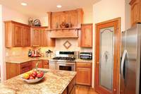 Thumb kitchen  traditional style  knotty oak  medium color  raised panel with arch  wood hood  standard overlay