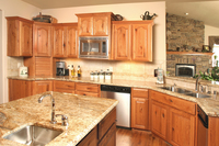 Thumb kitchen  traditional style  knotty oak  raised panel with arch  staggered heights  appliance garage  standard overlay