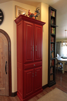 Thumb kitchen  traditional style  painted  raised panel  sand through  red  bookcase accent color dark stain  standard overlay