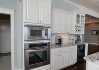 Thumb kitchen  traditional style  painted  raised panel  staggered heights  wine rack  glass door  standard overlay