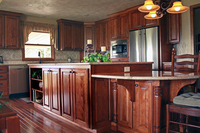Thumb kitchen  traditional style  red birch  dark style  raised panel island with posts and bar supports  standard overlay