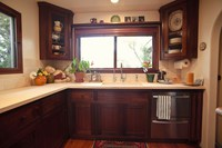 Thumb kitchen  traditional style  walnut  dark color  recessed panel  flush mount  diagonal corner uppers with glass doors