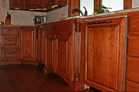 Thumb kitchen  traditional style  western maple  cherry color  raised panel  dishwasher front panel  legs  posts  feet
