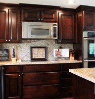 Thumb kitchen  traditional style  western maple  dark color  raised panel  floor to ceiling cabinets  deeper microwave hood  drawers under cooktop  standard overlay