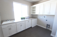 Thumb laundry or utility  shaker style  painted  recessed panel  open shelves  uppers above washer and dryer  standard overlay
